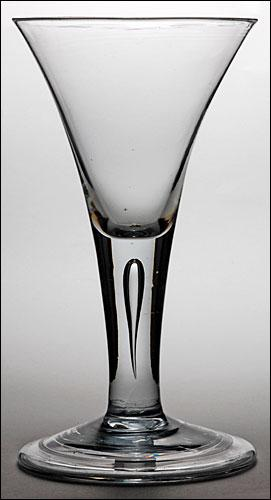 A drawn trumpet plain stem goblet (c. 1750) with unrecorded engraving.