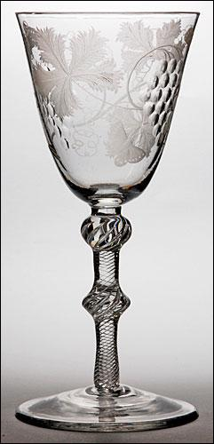 An engraved air twist goblet (c. 1760). double-knopped stem round funne